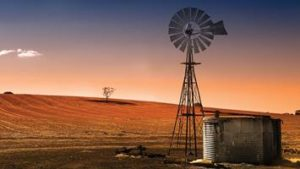 gi-a-au-south-australia-clare-valley-barren-land-with-windmill-at-sunset-4311134-b-16-9